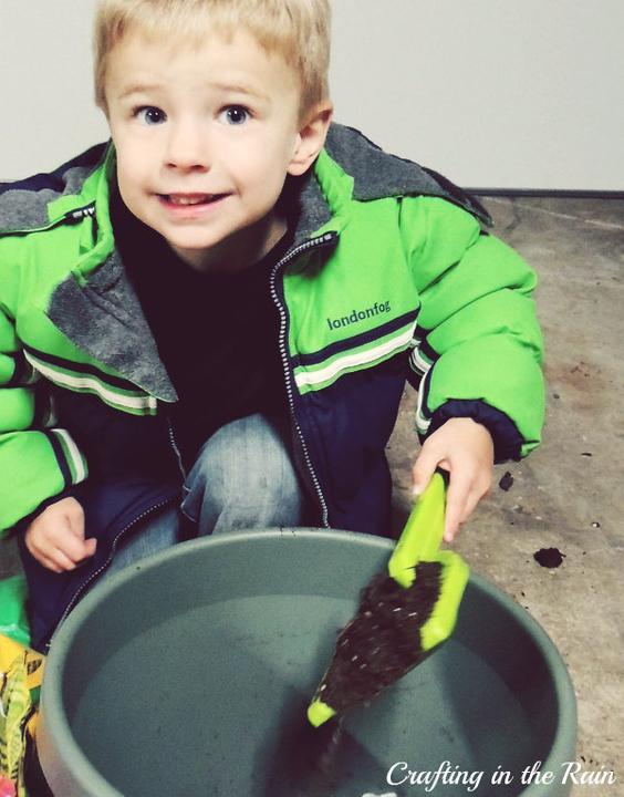 Kids help plant flowers
