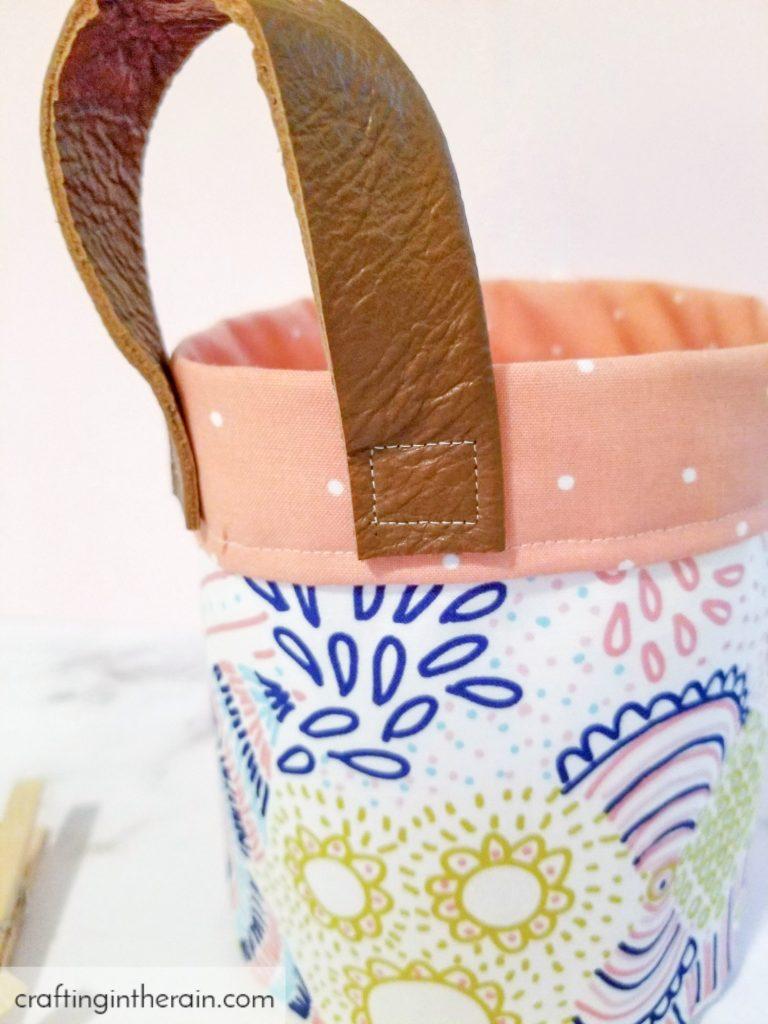 Leather handle on fabric basket