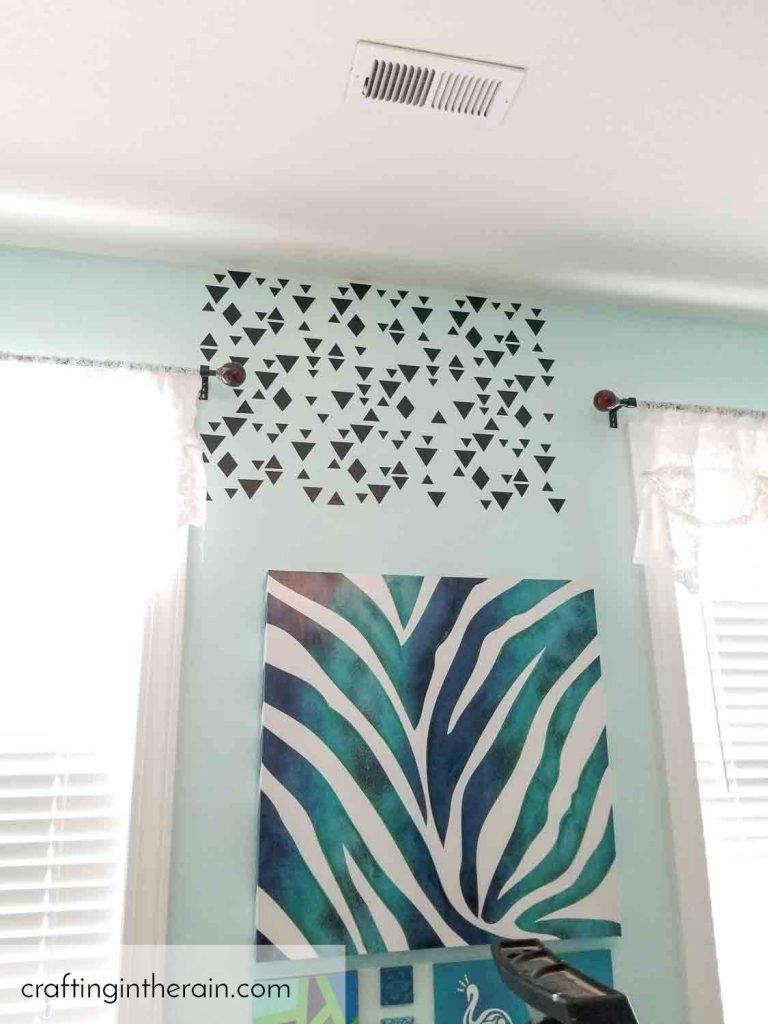 Black vinyl triangles on wall