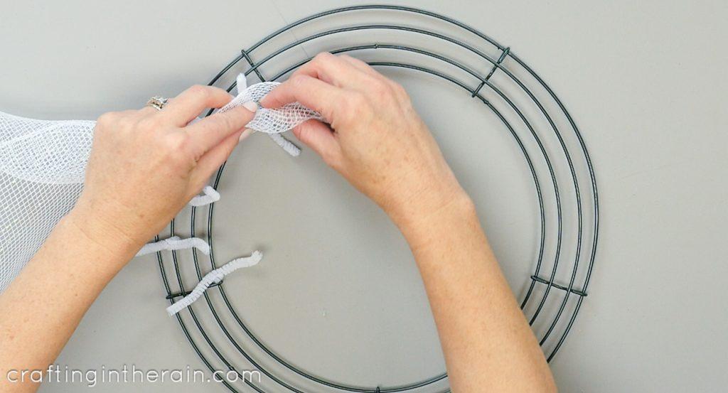 Attach mesh to wire wreath
