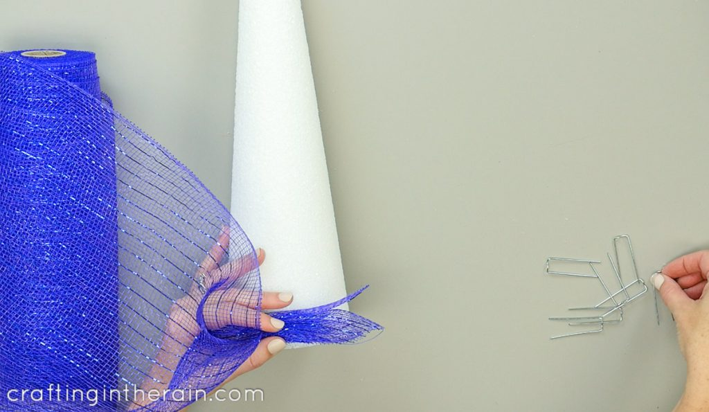 Decorate a foam cone with deco mesh