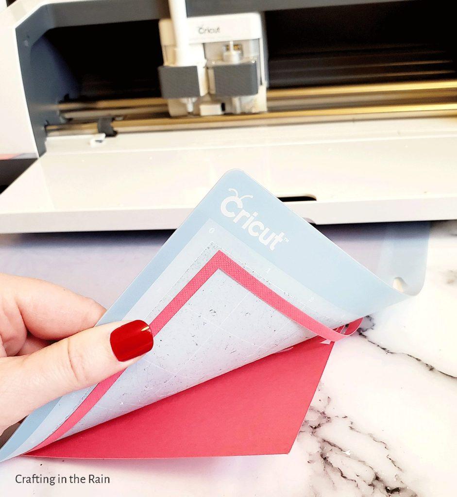 Paper curls off Cricut mat