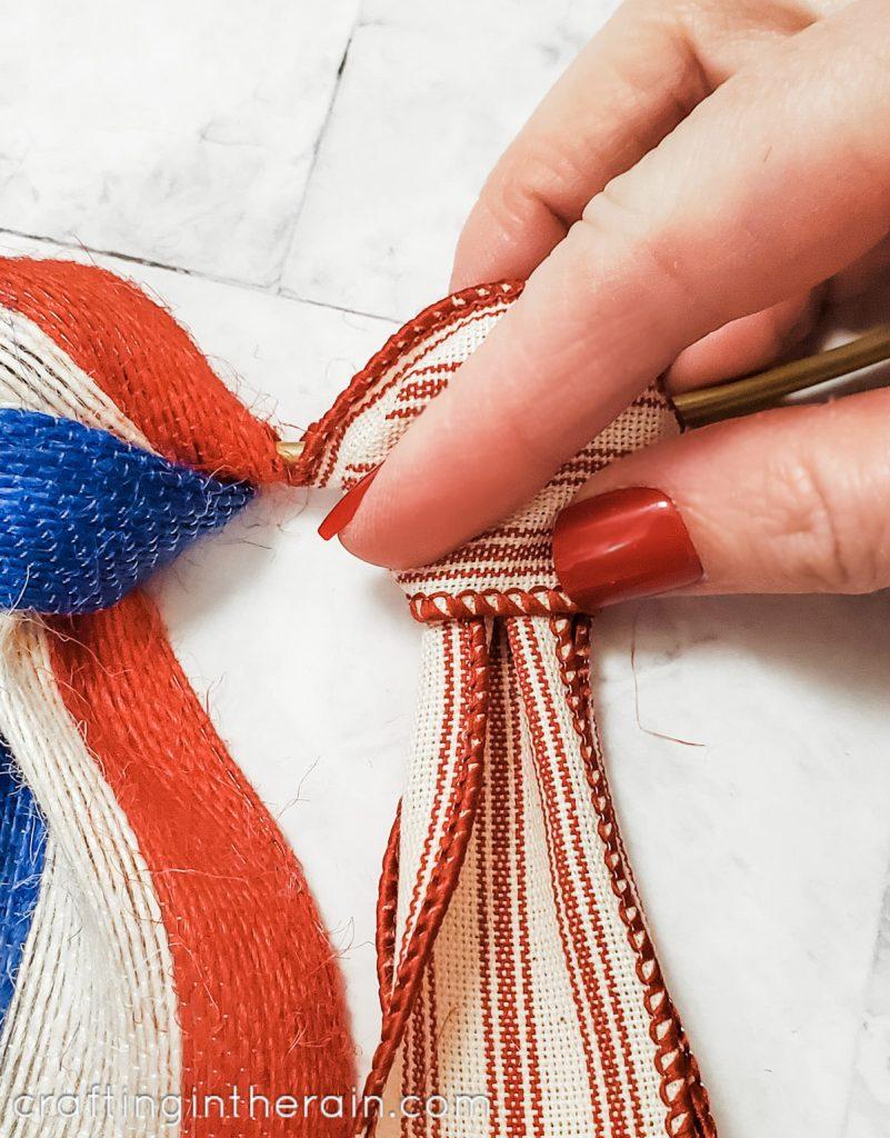 Tie ribbon on hoop wreath